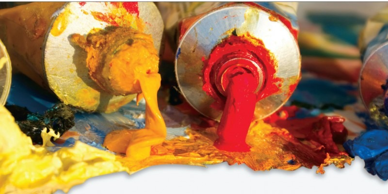 Photograph of tubes of paint, open with paint coming out