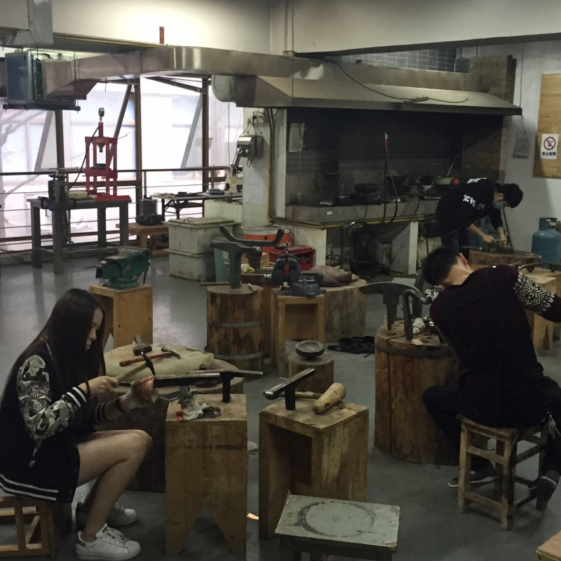 Students working in a jewelry studio at Nanjing University of the Arts