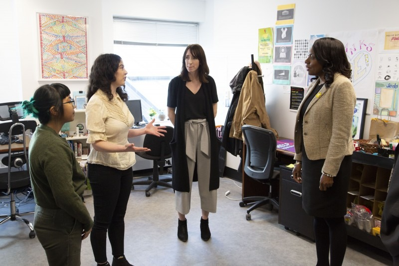 A group of female students speaking with Mitzie Hunter