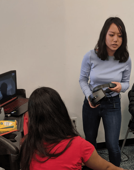 Inclusive Design student Nikki To (right) exploring VR technology with Priya Karthick  (left), research assistant for the projec