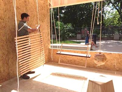 Sayyad Glassford installing a swing