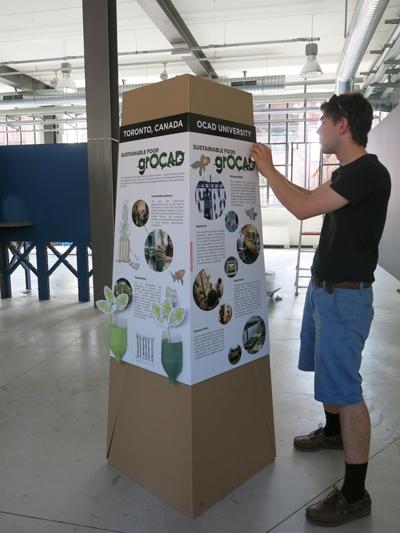 Man stands before a pop-up pylon