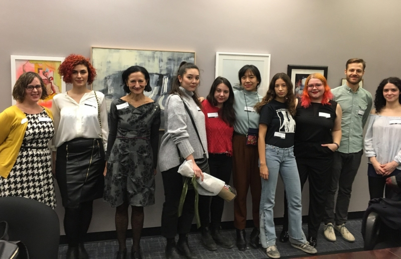 Artists standing with President Sara Diamond in front of exhibition