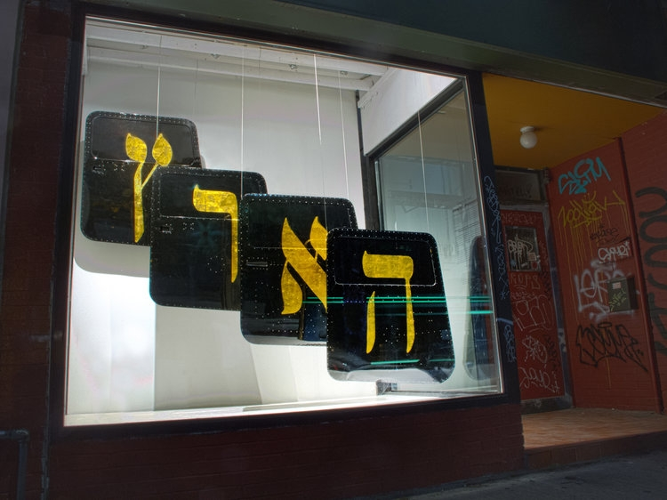 photo of artworks in storefront window
