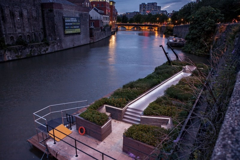 Image of a waterway at dusk with garden in foreground