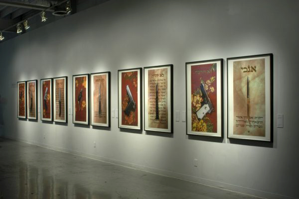 photo of photographs on gallery wall