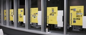 Photograph of Borough Posters installed in the windows of 49 McCaul.
