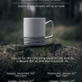 Dean's Coffee poster, coffee cup on a log in a forest