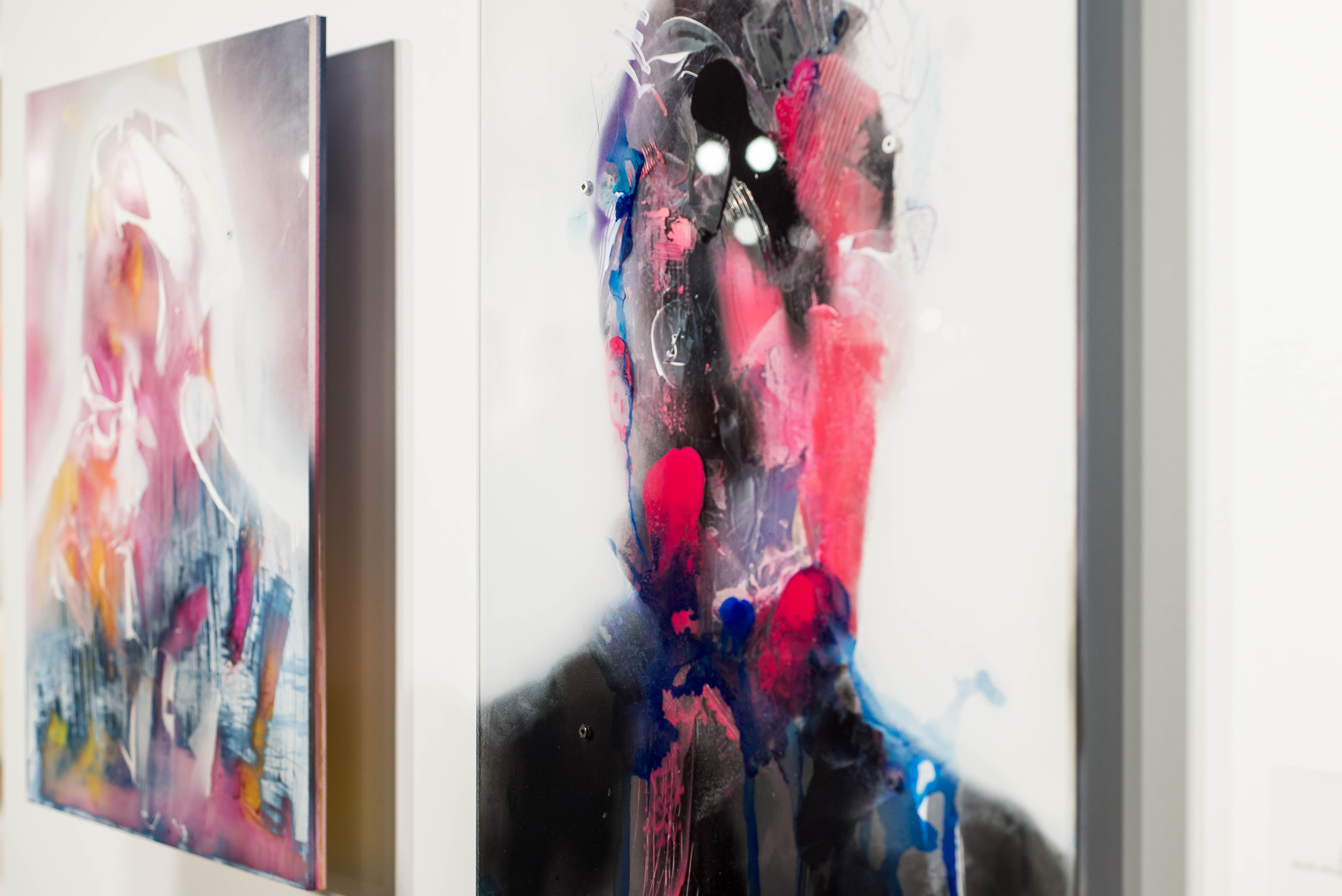 Two paintings of abstract faces