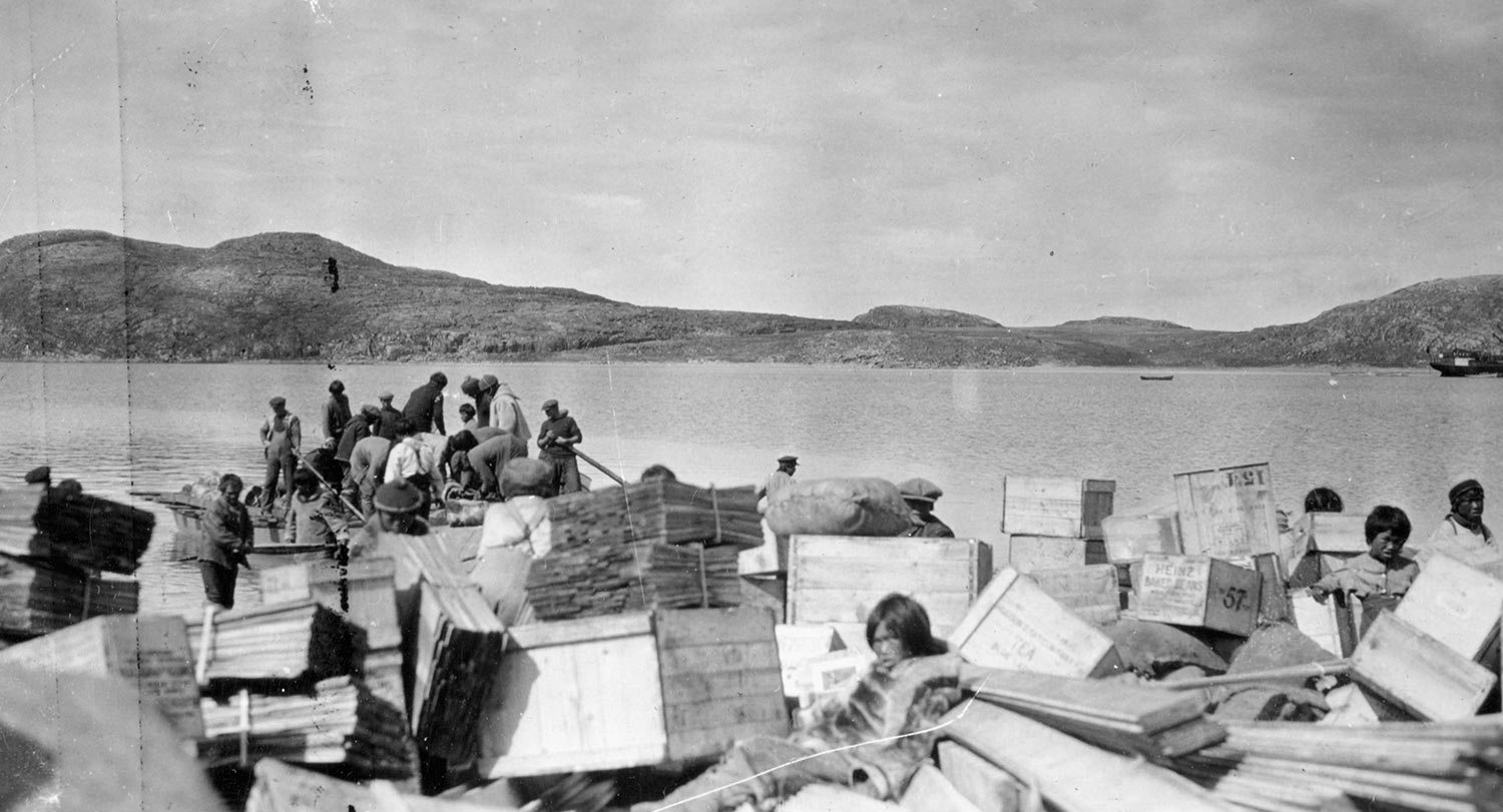 Wilfred Doucette, Inuit transporting supplies for the Royal Canadian Mounted Police (R.C.M.P.) from C.D. HOWE, Pangnirtung, 1951