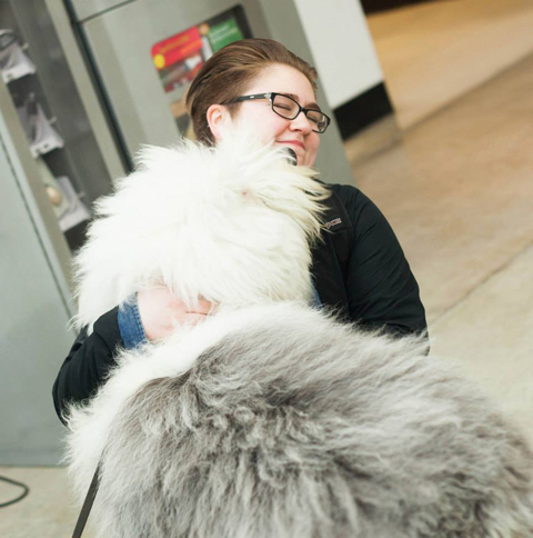 Norman gives a student a hug. Photo by Sarah Campbell.