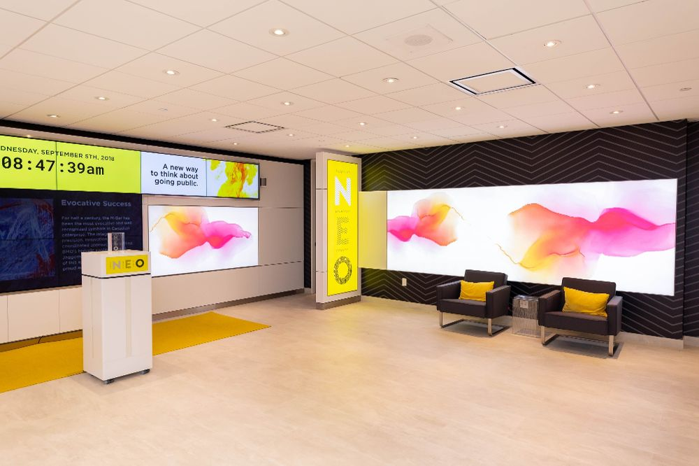 Neo exchange lobby pink and yellow decor and graphics