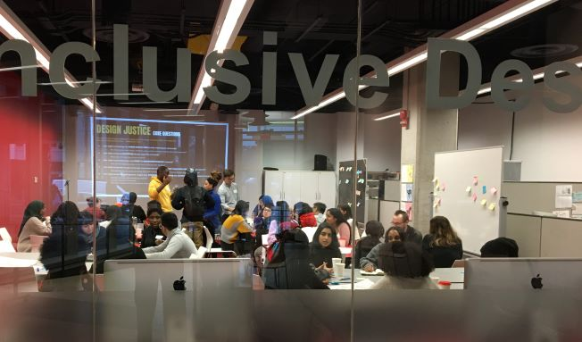 Image of Youth participants working in groups as part of the Creative Practice as Protest Workshop held at OCAD U in January 202