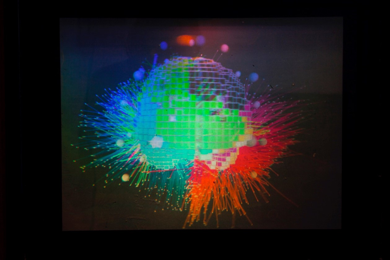 Image of a holograph of live brain scan, showing different active regions of the brain in red, green, and blue
