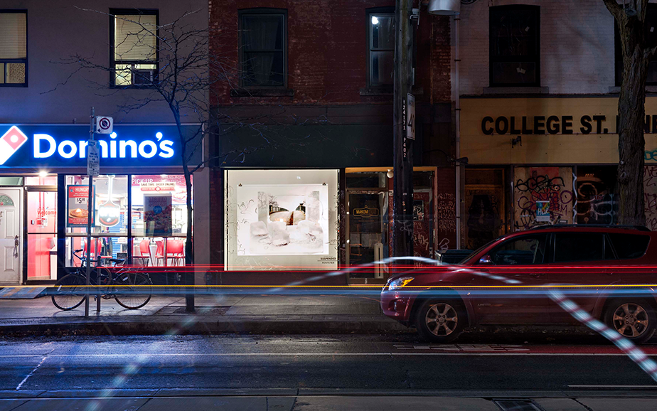 Photograph of the installation as seen at night, across the street on College St.