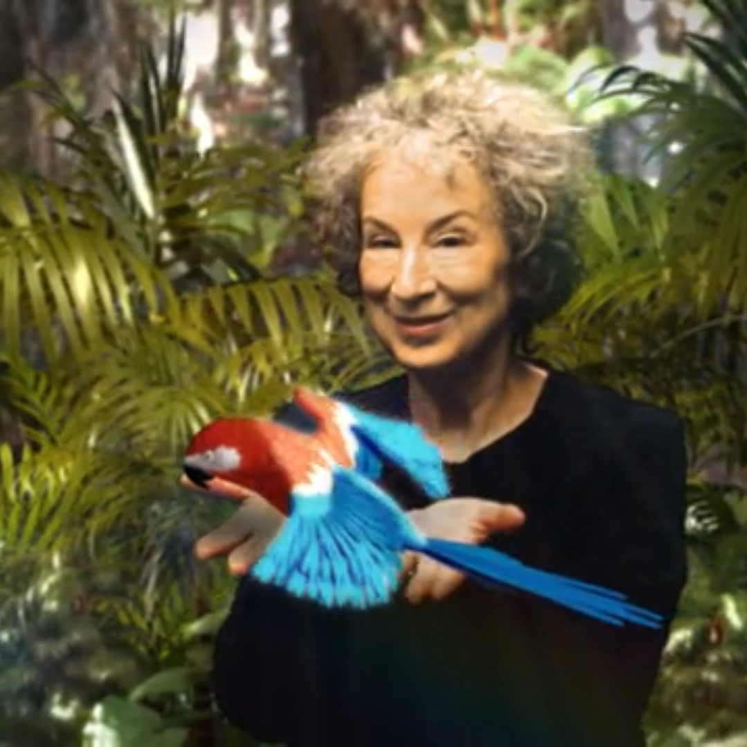 Portrait of Margaret Atwood made with the RAIL device. Margaret appears in a tropical forest holding a colourful parrot.