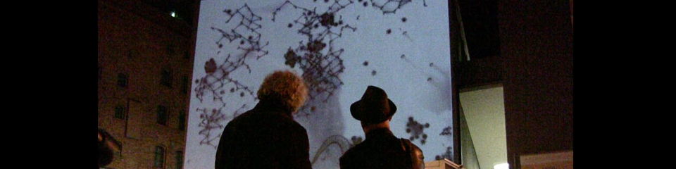 Image of people looking abstract images projected on a wall