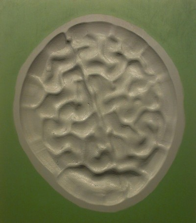a round artwork or sculpture moulded to look like a brain