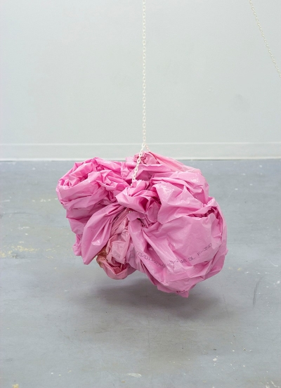 installation artwork including crumpled sheet of pink plastic