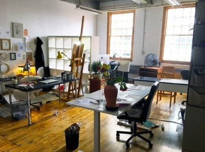 Photo of brightly lit studio in 401 Richmond with lots of natural wood