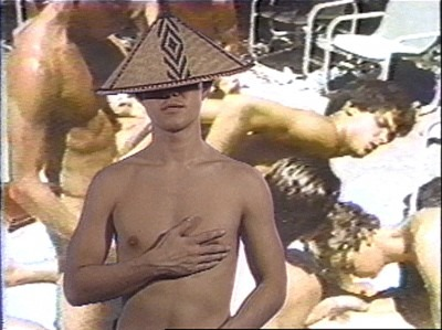 shirtless man wearing hat