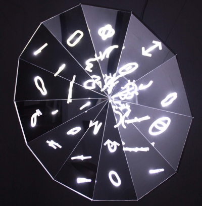 Image of a mirrored disk with lights and symbols