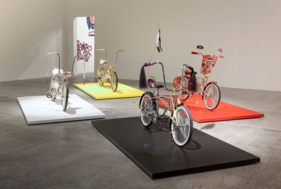 Art installation with three decorated bicycles