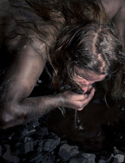 Image of person drinking water from hands