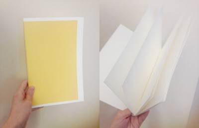 Two photographs of a hand holding a sketchbook, one with the sketchbook closed, the other with the sketchbook open