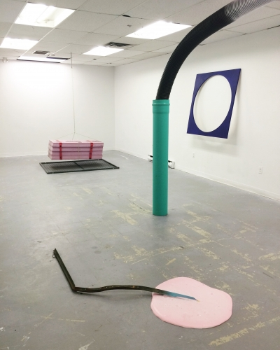 installation artwork including pvc pipe and styrofoam sheets