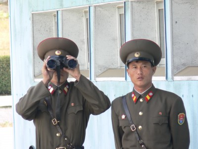 two soldiers, one with binoculars