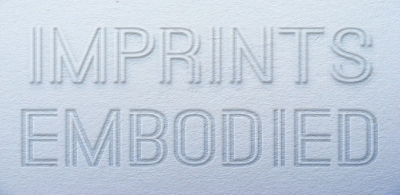 Imprints Embodied text on grey background