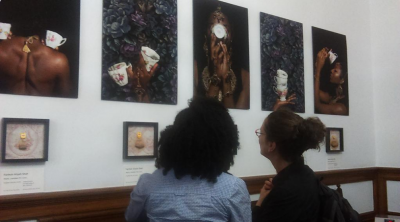 Visitors admiring the artwork on display