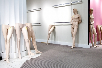Photograph of disassembled mannequins in an empty room