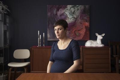 Photographic portrait of a woman behind a desk