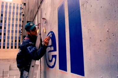 Image of Brian Deck working on a mural