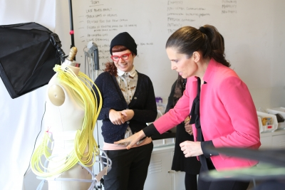 Minister Kirsty Duncan with student looking at wearable art