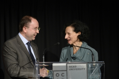 Image of Sara Diamond and Giuseppe Pastorelli at podium