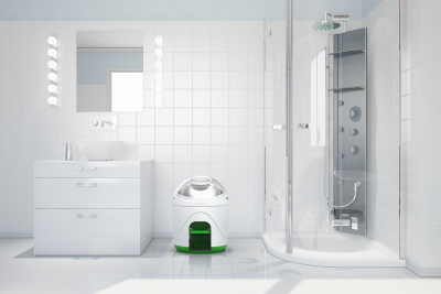 Image of the Drumi washing machine in a bathroom