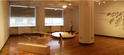 Gaia's Banjo installation, wooden platform with child walking on it