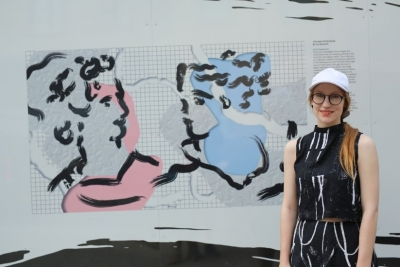 """Image of artist Cat Bluemke with her painting """"The New Patronage"""""""