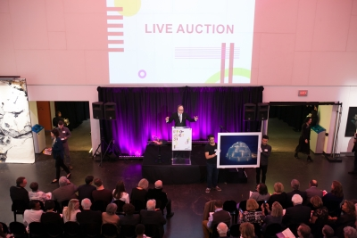 Auctioneer on stage