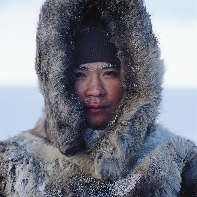 Photo of man with fur hood
