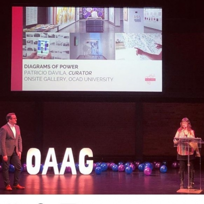 Lisa Deanne Smith accepts OAAG award on behalf of Onsite Gallery and Patricio Dávila