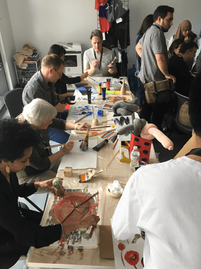 Group of VRTO participants making analogue paintings and sculptures to be imported into virtual space