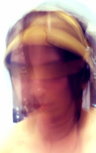 Image of blurred face wearing what appears to be a sheepskin hat