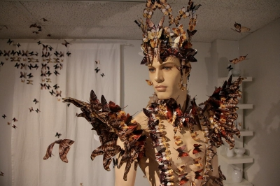 Image shows mannequin covered by butterflies made from pieces of visual porn