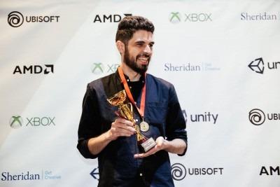 bearded young man, Ryan Mason, holding a trophy