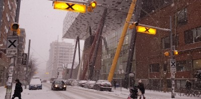 Exterior of 100 McCaul during snowstorm