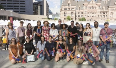 Group shot of Toronto Outdoor Art Fair winners by city hall